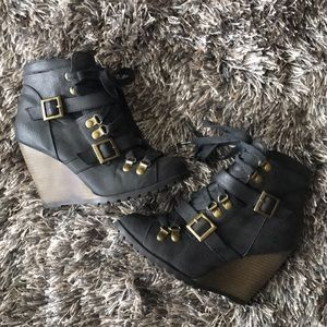 Black zippered lace-up/buckle wedge ankle booties